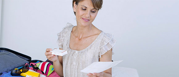 Travel Medicine Thumbnail Image Healthcare Program Woman Packing Medications