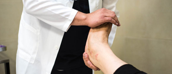 Diabetic Foot Care at Appletree Allied Health - doctor examining patient's foot