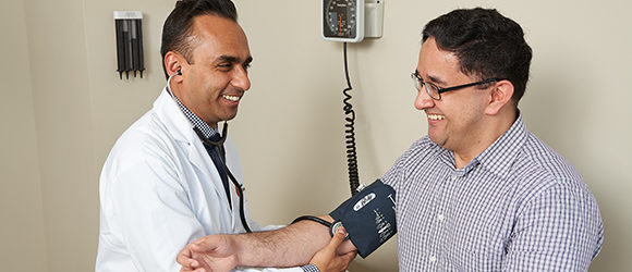 Appletree Hypertension Program patient and MD using a blood pressure monitor
